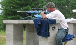 competition shooter using a BulzEyePro Optical Booster